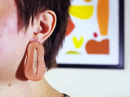 Creo Earrings - In Ear Closeup