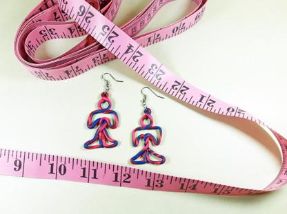 Figure Mini earrings for scale