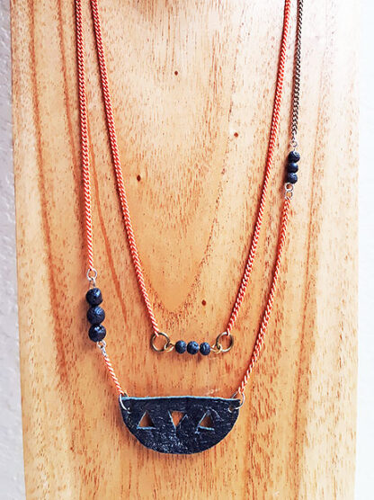 Two necklaces on display