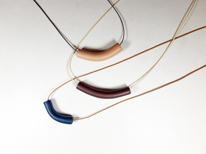 Tubular Necklaces displayed