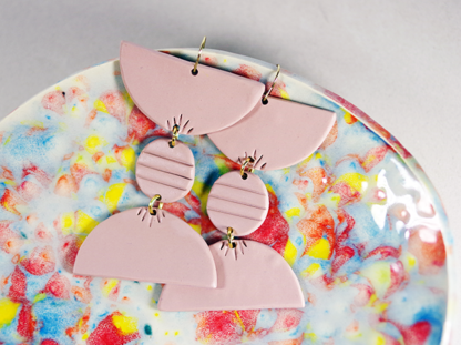 Totto Earrings in Chai on a dish