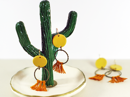 Angelique earrings on a cactus display