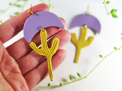 Calyxtus earrings in Lavender and Ochre in hand