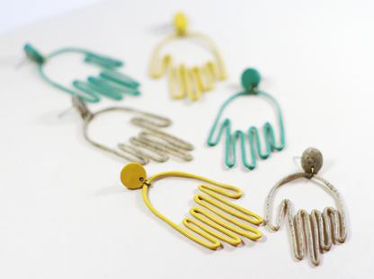 Matokie earrings in a group closeup