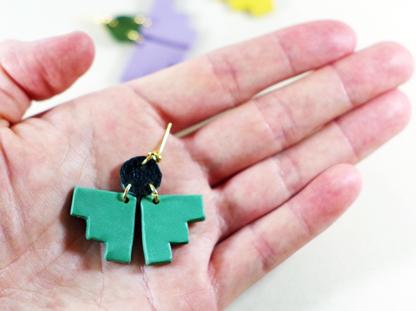 Pioneer earrings in hand