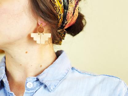 Pioneer earrings in ear